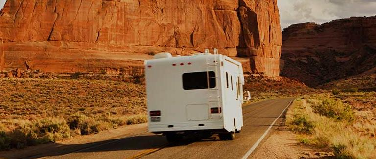 New RV on open road bought with loan
