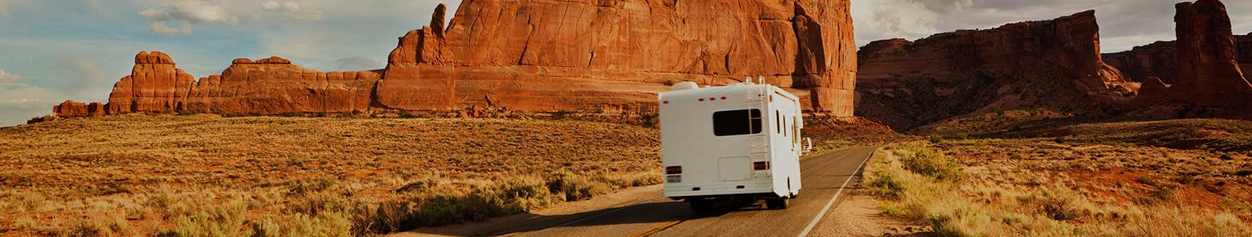 A brand new RV driving down the road